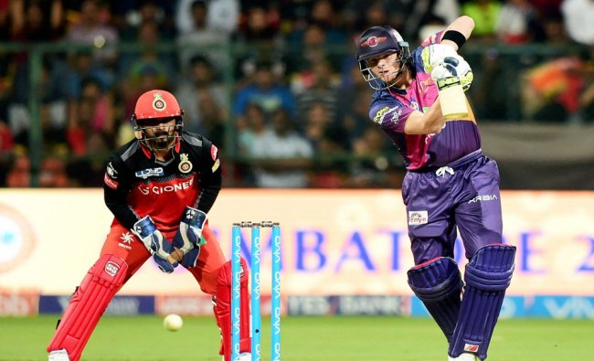 Rising Pune Supergiants Steve Smith plays a shot during the match between Royal Challengers ...
