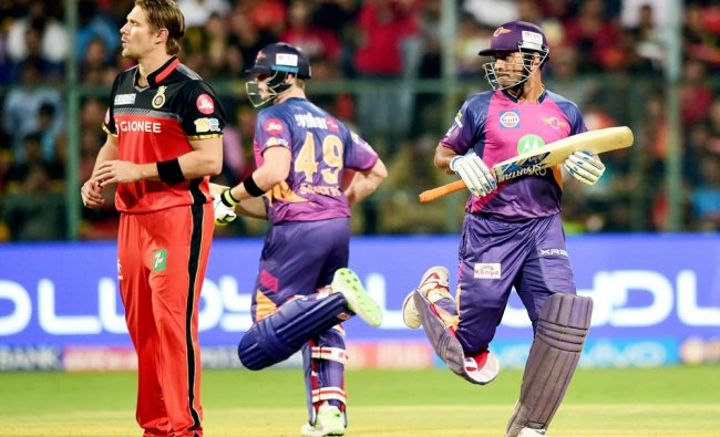 Rising Pune Supergiants M S Dhoni and Steve Smith runs between the wicket during the match between..