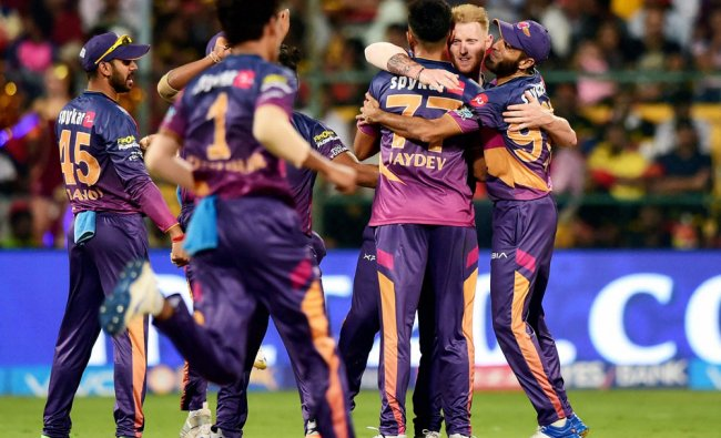 Rising Pune Supergiants Ben Stokes with team mates celebrate the wicket of Shane Watson during the..