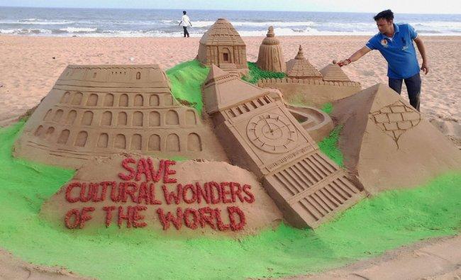 Sand artist Manas Sahoo creates a sand sculpture on eve of World Heritage Day