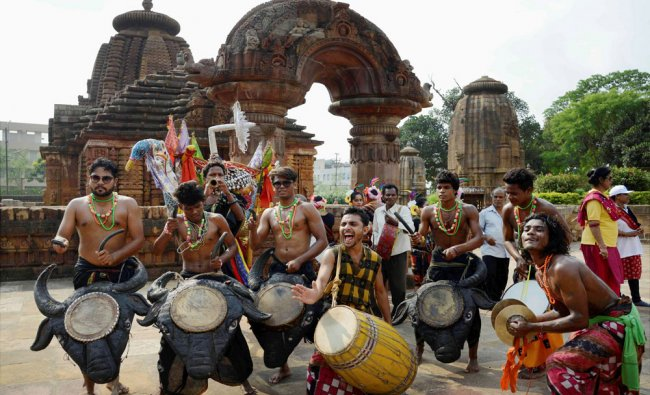 Folk artists performing in front of 10th century old Mukteswar temple in Bhubaneswar to mark...
