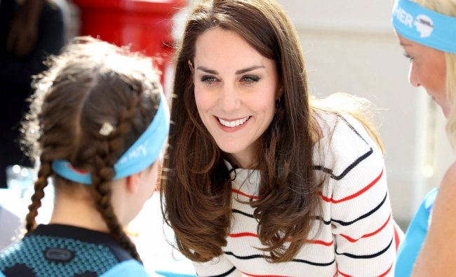 Princess Catherine, Duchess of Cambridge speaks with runners from Heads Together charity...