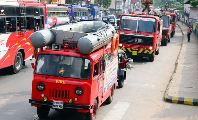 Fire service persons take part in valedictory of Fire Prevention Week rally from Jyothi Circle...