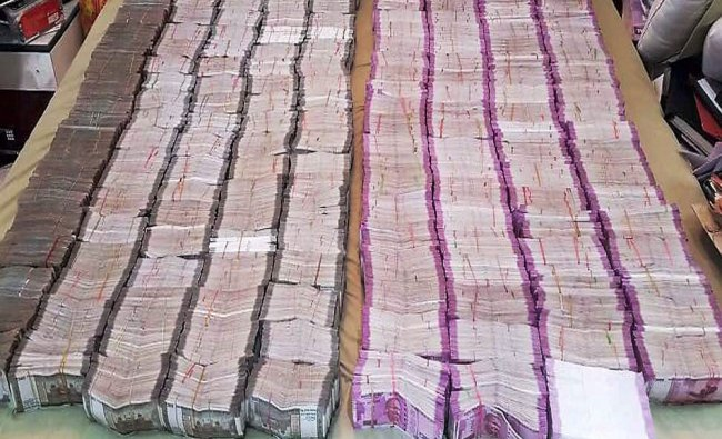 Cash in new currency notes recovered after raid at the residence of an Uttar Pradesh Additional...
