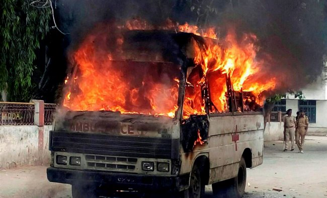 Angry ppeople set on fire an ambulance after clash between doctors and attendants...