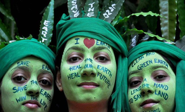 School girls with painted faces during \'Save Earth\' awareness program on the eve of World Earth...