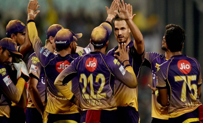 KKR bowler Coulter-Nile (C) jubilate with his teammates after dismissed Gujarat Lions batsman...