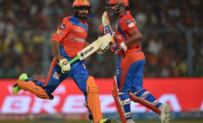 Gujarat Lions batsman Suresh Raina and R.Jadeja cross each other to complete a run during...