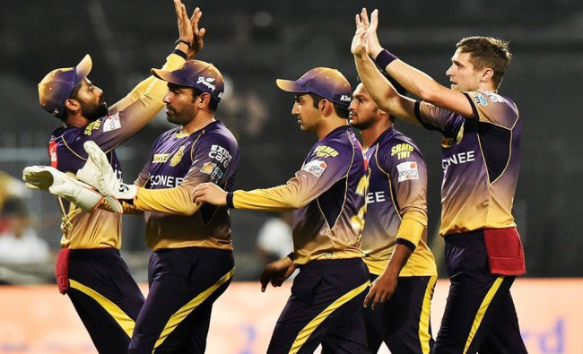 KKR cricketers celebrate the wicket of B McCullum during IPL match against Gujarat Lions...