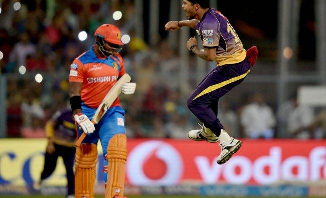 KKR bowler Umesh Yadav celebrates the wicket of Gujarat Lions batsman D.Smith during IPL...