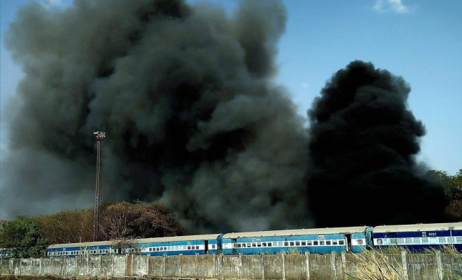 Smoke billows out after a major fire broke out in Railway Coach Factory at Nishatpura in Bhopal...
