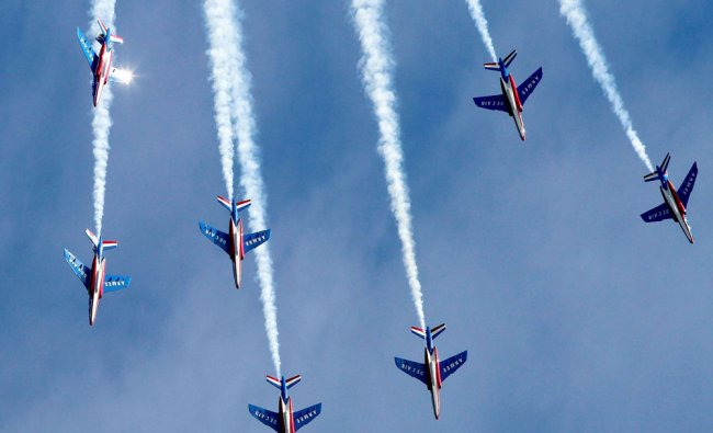 The French air force\'s Patrouille Acrobatique de France aerobatic team performs at Langley...