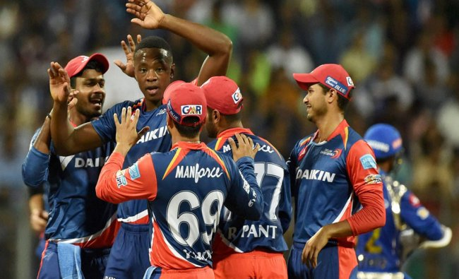 Delhi Daredevilss players celebrate the dismissal of Parthiv Patel during the IPL match...