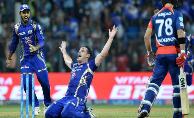 Mumbai Indianss player Mitchell McClenaghan celebrates the dismissal of Anderson during...