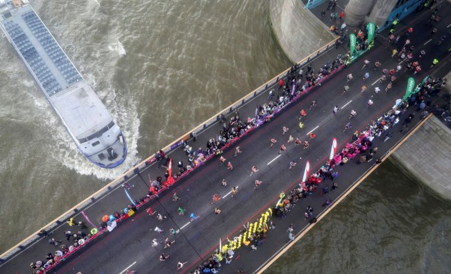 Runners make their way over Tower Bridge during the London Marathon