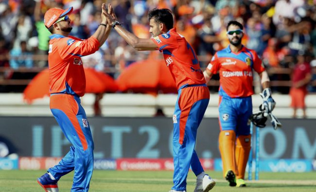 Suresh Raina with Shubham Agarwal celebrates the wicket of Hasim Amla