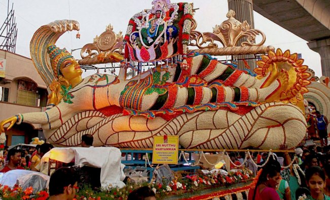Floral chariots part of a procession during the annual \'Ulsoor flower Pallakki Festival\'