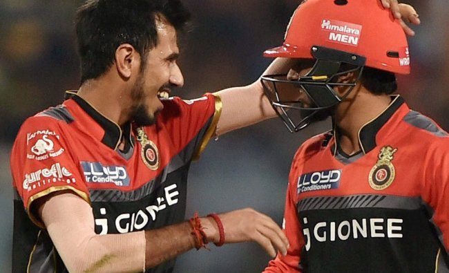 Chahal celebrates with Jadhav after the dismissal of Pathan