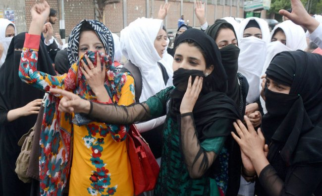 College girls shout slogans at a protest against the recent police action on students, in Srinagar..