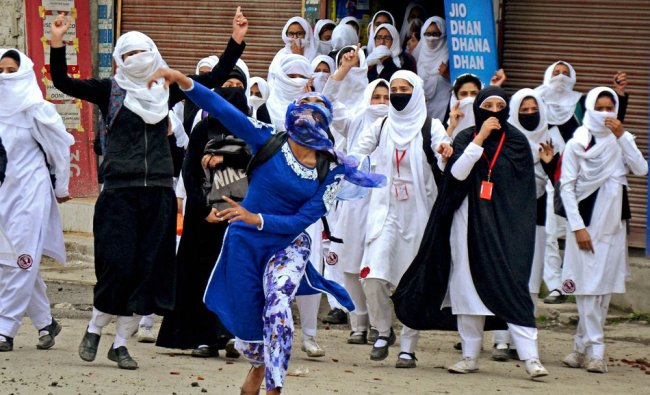 Girl students pelt stones at security personnel during clashes in the vicinity of Lal Chowk in ...