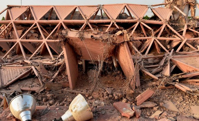 Remains of the iconic Hall of Nations structure at Pragati Maidan in New Delhi on Monday...