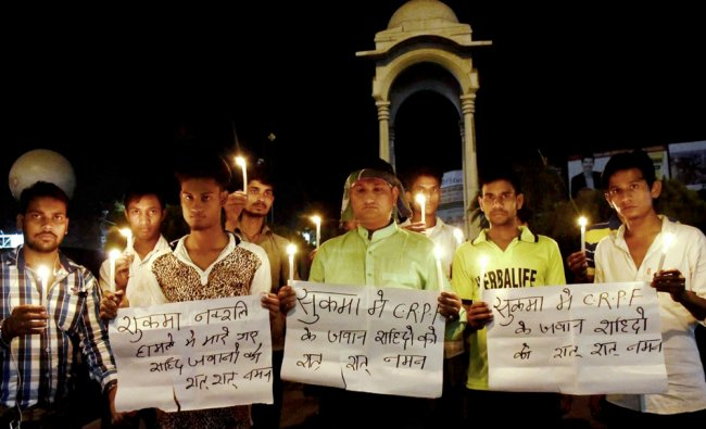 LJP activists take part in a candle light vigil to pray for CRPF jawans lost their lives in a ...