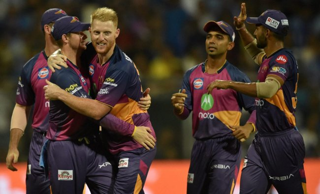 Rising Pune Supergiants players celebrate the dismissal of Jos Buttler during the IPL match ...