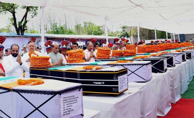 Union Home Minister Rajnath Singh paying tribute to CRPF jawans killed in the naxal attack in ...