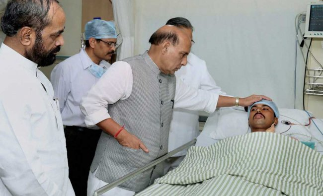 Union Home Minister Rajnath Singh enquiring about the health of injured CRPF personnel at the ...