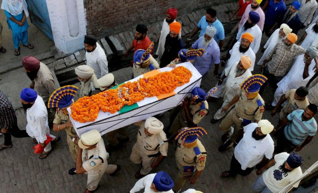 CRPF martyr Inspector Raghbir Singh being carried during his funeral in village Sathiala, some 50 ..
