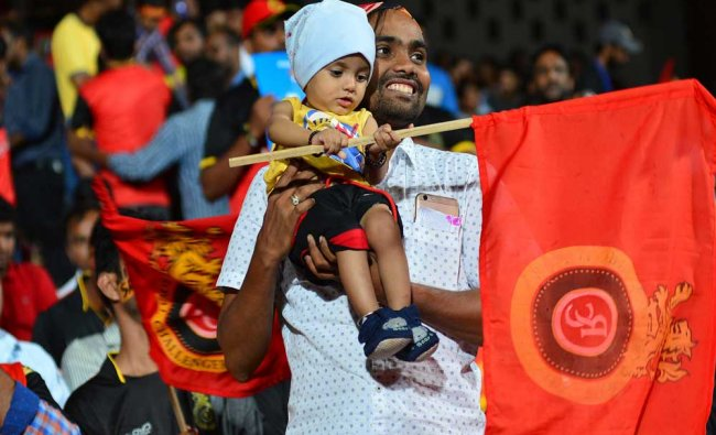A large number of RCB cricket fans cheers during the 2017 Indian Premier League (IPL) Twenty20 ...