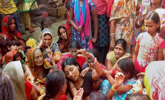 Family members of CRPF jawan Naresh Yadav, mourn in Darbhanga on Wednesday. He was martyred in...