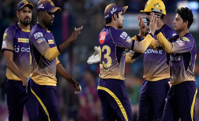 Kolkata Knight Riders players celebrate the dismissal of MS Dhoni during the IPL match against...