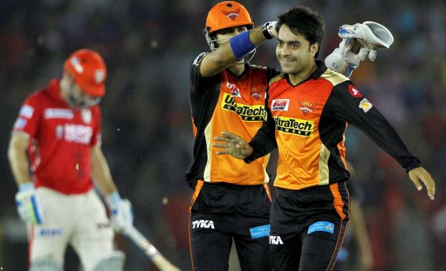 Rashid Khan Arman of the Sunrisers Hyderabad celebrates the wicket of Eoin Morgan of Kings...