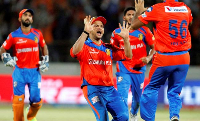 Gujarat Lions bowler celebrates the wicket of Mumbai Indians batsman Mitchell McClenaghan during...