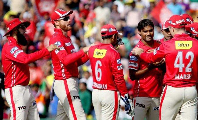 Kings XI Punjab player Sandeep Sharma celebrating with his teammates the wicket of Delhi Daredevil..