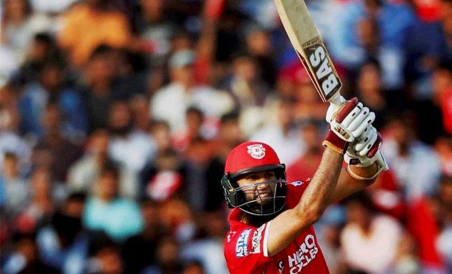 Hashim Amla of Kings XI Punjab plays a shot during IPL match against Delhi Daredevils in Mohali...