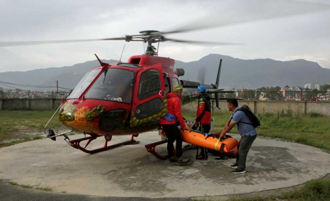 A helicopter carrying the body of famed Swiss climber Ueli Steck arrives at Teaching Hospital...
