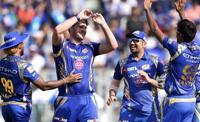 Mumbai Indians bowler Mitchell McClenaghan celebrates with his teammates after dismissing RCB...