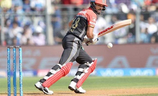 Royal Challengers Bangalore batsman Virat Kohli plays a shot during the IPL match against Mumbai...
