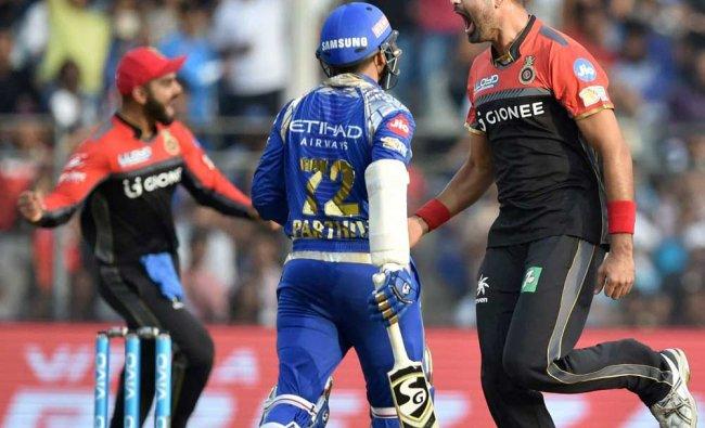 Royal Challengers Bangalore bowler Aniket Choudhary celebrates the wicket of Mumbai Indians...