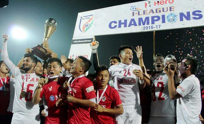 Players of Aizawl Football Club celebrates and poses with the trophy after they won the I-League...