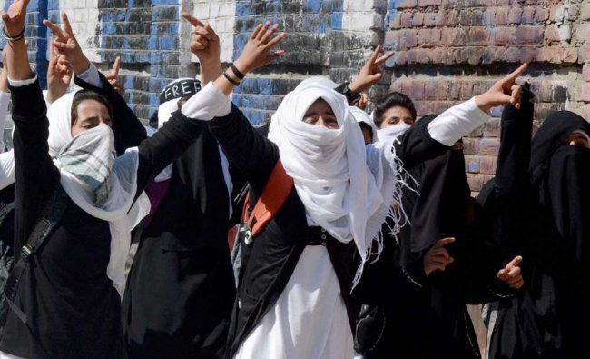 Women\'s College students shout slogans during a protest rally against the police action....