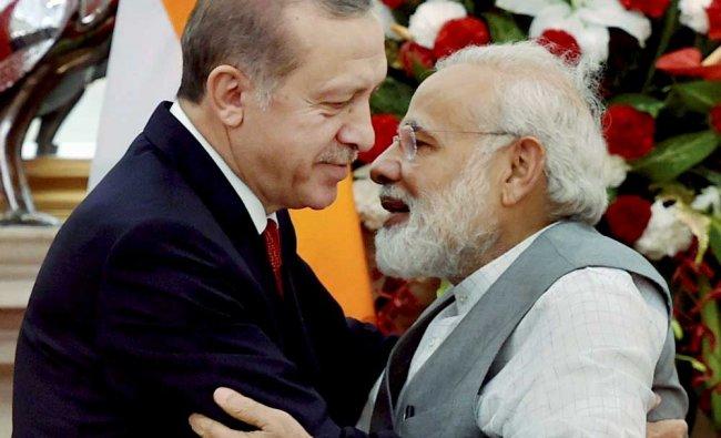 Prime Minister Narendra Modi greets Turkish President Recep Tayyip Erdogan after their joint press..