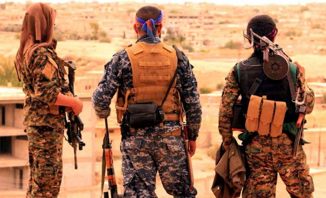 Fighters from the SDF looking toward the northern town of Tabqa, Syria. U.S.-backed opposition...