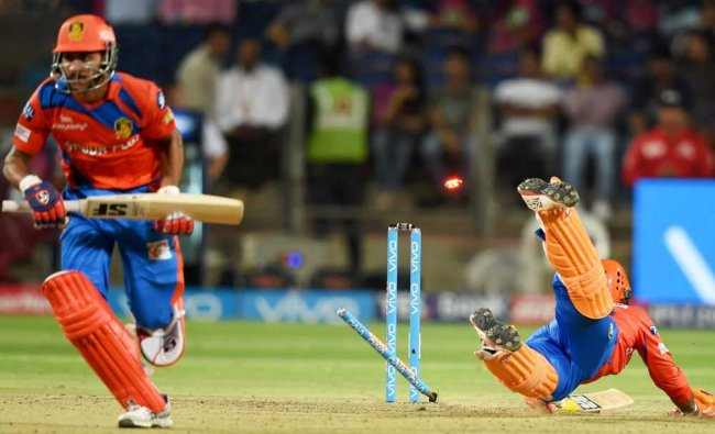 Gujarat Lions batsman Dinesh Kartik run out during the IPL T20 match played against RPS...