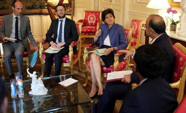 France\'s Defense Minister Sylvie Goulard, center, talks with her Indian counterpart...