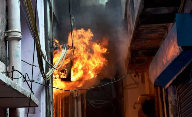 Flames billowing out after fire breaks out in a building in Kinari Bazar...