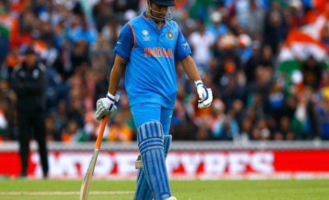 India\'s MS Dhoni walks off after being dismissed...
