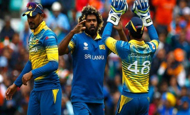 Lanka\'s Lasith Malinga (C) celebrates taking the wicket...